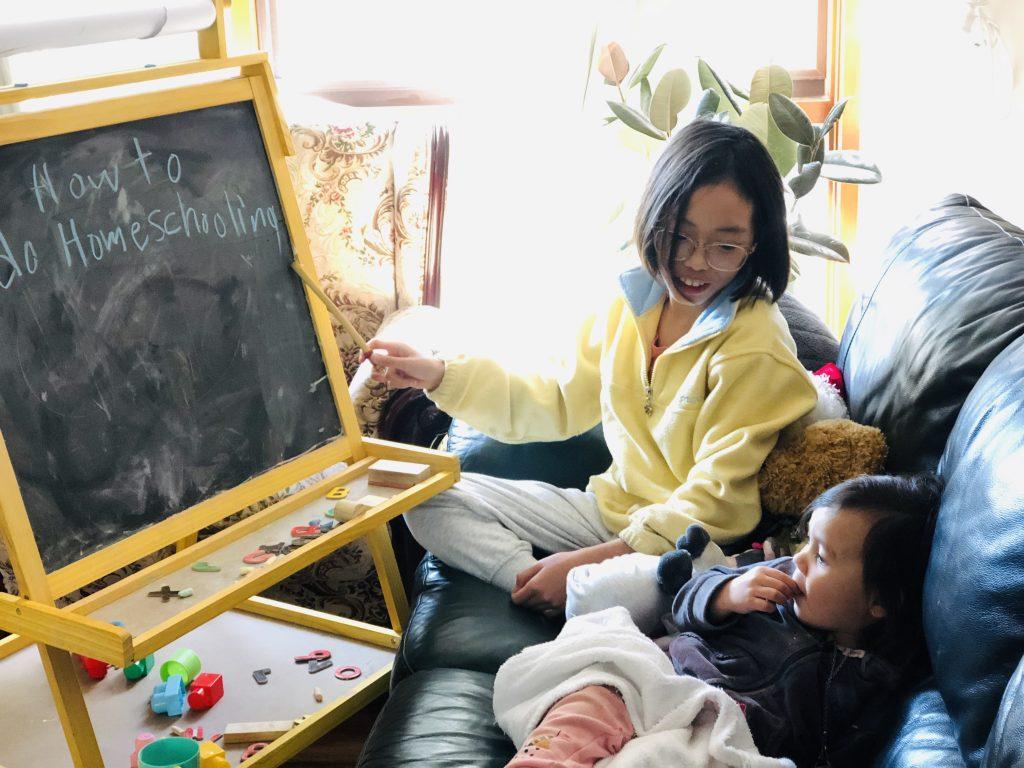 Larah Heinrich homeschooling her daughters.